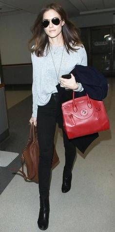 ALLISON WILLIAMS The Girls actress looked refreshed and chic after arriving in Los Angeles for the Golden Globes. She paired black skinnies with a loose-fitting grey shirt, black booties, black aviator sunglasses, a brown tote, and a red satchel for the trip.