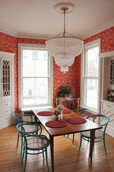 An already gorgeous Victorian house has been energized with bold color. | House Tours by Apartment Therapy #diningrooms #diningroomideas #colorfuldecor #colorpalette #victorian #victoriandecor #victorianhomes #colorfuldecor #diningtable #chandelier #vintage #vintagedecor #vintagehome