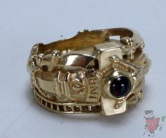 This James Avery band is a recreation of the ring commemorating the marriage of Martin Luther and Catherine von Bora on June 13, 1525. The designs on the ring represent symbols of the Passion of Christ which include reeds, a sword, the inscription INRI, dice, spear, reed of hyssop, sponge soaked with vinegar and a 4mm round cabochon garnet representing Christ's blood.