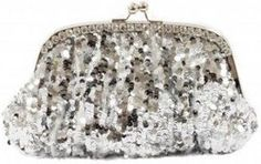 Can I carry a silver clutch bag with a red dress & black heels to my Christmas Party?