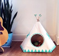 """Made to order. Please allow two weeks from purchase date to ship. I created a cat teepee originally to house our neighborhood kitty during the cold nights, and she's since made it her new home. We couldn't help passing this on to all the other little animals to enjoy!The Raven Black, Dog Teepee comes with a 1"""" removable and hand washable bed, made of a soft, Blizzard Fleece material that your dog will love! The comfortable bed is perfectly fitted to the the shape of you..."""