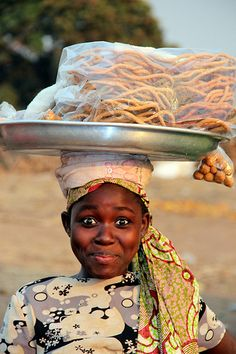This young girl and her friends were wandering around the market of Techiman, Ghana. I bought some of her products and handed around. Quite tasty although I have no idea what they were.