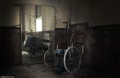 Wheelchairs abandoned in the hospital. Ospedale Psichiatrico di Volterra, a former psychiatric hospital in Tuscany, Italy.
