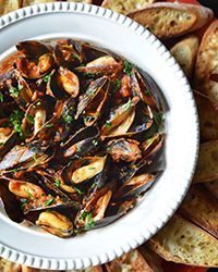 F&W contributing editor Andrew Zimmern recommends using plump, wild Mediterranean mussels from Maine or Penn Cove mussels from the Pacific Northwest in this recipe. Simple and elegant, it's a classic summer dish that is best served with lots of crusty bread for dipping.Slideshow: Mussels