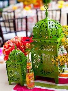 I love everything on this webpage...hot sauce bottles with a flower in them, printed tin cans as vases...