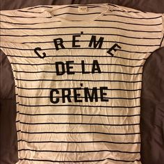 "Creme de la Creme tee size M Tell the world who you are - the best of the best! On trend striped, soft short sleeve tee emblazoned with - ""Creme de la Creme"" in a bold font. Black stripe and logo color on white. Baggy, slouchy fit. Perfect with skinnies and booties for a relaxed wknd look. Worn just a couple of times, purchased at Nordstrom rack. Nordstrom rack Tops Tees - Short Sleeve"