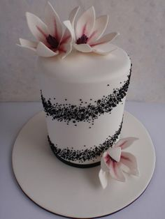 Pale pink and black double barrel cake with lillies