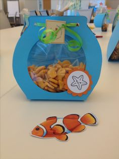 """""""Finding Nemo"""" baby shower theme at work. Fish bowl favor waaaaay cute!!! The end product of a group collaboration and team work! Woohoo!!!!!"""