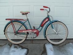 Vintage 1950's I had a pink one with a basket in the front horn and streamers on each side of the handle bars.  It was heavy but I loved that bike.  This show not so pretty. red and blue girls bicycle bike with whitewall tires