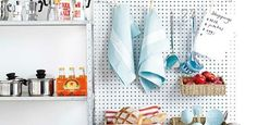 Pegboard for kitchen.  Like the string across the top to clip things.