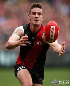 Michael Hartley of the Bombers in action during the 2016 AFL Round 02 match between the Melbourne Demons and the Essendon Bombers at the Melbourne Cricket Ground, Melbourne on April 2, 2016.