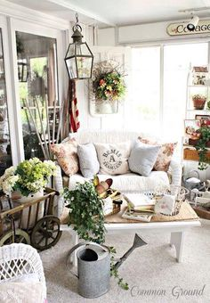 Such a cozy little sun room porch! I love all the plants. They really bring life to the space and it's a perfect place for them to flourish in the sun. The cottage style couch is adorable and makes the room much more cozy and welcoming. Never would have thought to add a shelf for decor into a sun room, but it really makes it feel like an extension of the house instead of a closed in porch.