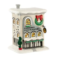 The Peanuts Village Series, by Department 56 - who can resist Charlie Brown, Snoopy and the whole gang? Inspired by the one of the best loved holiday classics. Schroeder's Piano Playhouse, one of the charming, lit buildings from this series. Hand-crafted, hand-painted ceramic, includes light-cord with bulb.