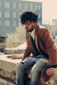 Shop this look for $191:  http://lookastic.com/men/looks/white-longsleeve-shirt-and-navy-cardigan-and-camel-overcoat-and-blue-jeans/1191  — White Vertical Striped Longsleeve Shirt  — Navy Cardigan  — Camel Overcoat  — Blue Jeans