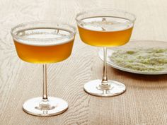 Sidecar Martini : Giada's riff on a sidecar cocktail adds sunny limoncello to the shaker, sweet-and-sour mix and a lime zest and sugar-dipped rim.