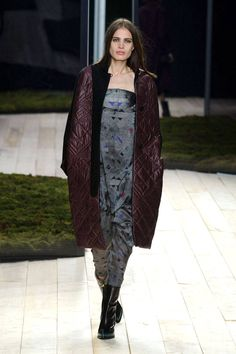She had one of the neatest puffers yet—a maroon cocoon that was utterly simple but very cool. The maroon touches played nicely against the gray-grounded abstract printed slip dresses and jumpers in easy shapes.   - HarpersBAZAAR.com