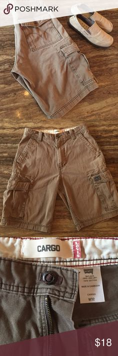 LEVI'S CARGO SHORTS MENS SIZE 32 These are a very nice pair of preowned men's Levi's cargo shorts in a light brown color,  shorts only for sale.  Shoes are for sale in another listing.  The waist measures 16 1/2 inch flat waist measurement.  And the total length is 22 inches and the rise is 13 inches.  Thanks for looking.   See photos for better details.  Any questions please ask.  I do not do trades!! Levi's Shorts Cargo