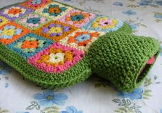 From Alexandra MacKenzie....  Granny square crochet hot water bottle cover...who wouldn't want to snuggle up with one of these...so cute