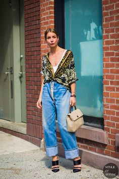 Irina Lakicevic wearing Dries Van Noten shirt, Off-white jeans between the fashion shows.