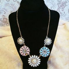 **SALE** statement necklace Super gorgeous statement necklace, with multi-colored resin rhinestones and crystals.  Has a good weight to it, but not too heavy that would bother you.  Very beautiful piece that goes with any style.  Unfortunately one of the rhinestone is missing after my little girl played with it for a minute.  So I have to discount it heavily. Jewelry Necklaces