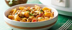Too busy to cook but craving some good old fashioned comfort food? Our slow-cooker taco pasta combines pasta with ground beef, tomatoes, onions, taco seasonings and chile cooking sauce for a simmered-to-perfection hearty dish.