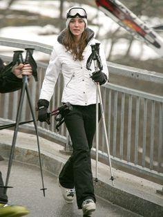 Same white ski jacket, black ski pants.                                                                                                                                                                                 More