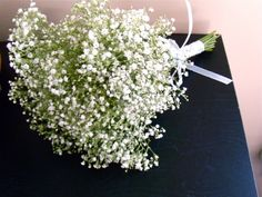 Another pin spray painted baby's breath to match wedding colors.....baby's breath