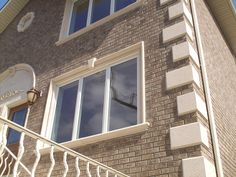Home with #precast concrete window surrounds, quoins and sills.