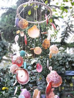 Colorful Sea Shell Wind Chime by 27nokta10 on EtsyThis perfectly designed hanging mobile is 100% handmade.   Held together with fish line to the hoop and decorated with colorful sea shells and colorful handpicked beads. This beauty, smoothly sounds through the wind.  You may choose as a very special gift.   May hanging window or ceiling or uses for the garden.  We accept custom orders.  Special requests are always welcomed.