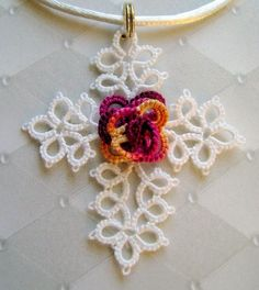 Eternal Rose Cross.  Free pattern on Craftsy.com. Tatting.  Never tried it, but this is a beauty.