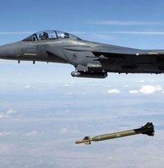 Air Force Strike Eagle aircraft releases a ' Bunker Buster'' Laser-Guided Bomb over the Utah Test and Training Range, August Fighter Aircraft, Fighter Jets, Airplane Wallpaper, Military Memes, Military Post, Military Weapons, American Fighter, Military Aircraft, Air Force
