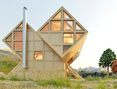 Geometric Timber Home Inspired by Dolomite