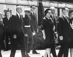 Joe DiMaggio attends the funeral of Marilyn with his son Joe Junior and Monroe's half-sister Bernice Miracle.
