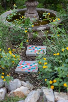 These stenciled garden stepping stones use inexpensive concrete pavers, tape, and weather-resistant paint to create a colorful, modern honeycomb design guaranteed to liven up any garden.