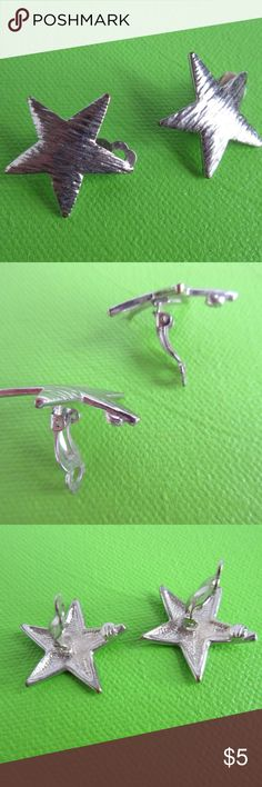 """Brushed metal star clip earrings Cute little earbobs, about 1"""" wide, clip-on is still tight and in good shape. I probably wore them twice and then they languished in my jewelry box forever. Love them but I'm de-accessorizing this year. Take advantage of the bargain! Jewelry Earrings"""