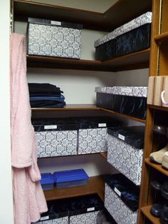 cardboard boxes covered with coordinating contact paper create a neat, cohesive look for a master closet