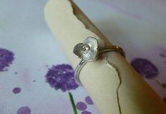 #ellebee on Artfire       #ring                     #Tiny #Sterling #Silver #Flower #Ring #with #Crystal                          Tiny Sterling Silver Flower Ring with Crystal                                 http://www.seapai.com/product.aspx?PID=1231383