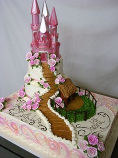 Castle Cake  Castle Cake two tier set on full sheet. Buttercream icing. Airbrush work on full sheet.  #castle #fairy-tale #fairy #hogwarts #dragon #cakecentral