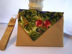 Tan Envelope Clutch with Print Flap. $20.00, via Etsy.