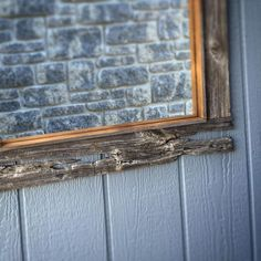 It's all in the details. This board was so neat I figured a mirror would be an awesome way to showcase it. Funny that the brick wall reflection looks like a wall over top of the siding. Brick Wall, Reflection, It Works, Frames, Rustic, Photo And Video, Interior Design, Mirror, Awesome