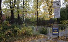Obama Chicago House Security | You can just glimpse the Obama home beyond the barriers and through ...