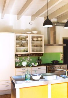 Stainless steel appliances and green back splash.