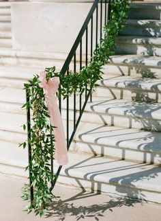thin ruscus garland: stairs, railing, ceremony entrance