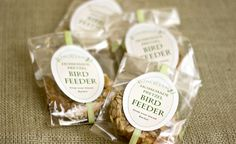 homemade bird feeders made from pretzels, nut butter and seeds . Print labels for a cute wedding favor idea.