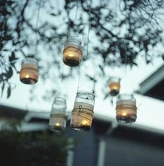 HANGING MASON JAR CANDLE HOLDERS (Wrapped with wire and hung from inexpensive chain)