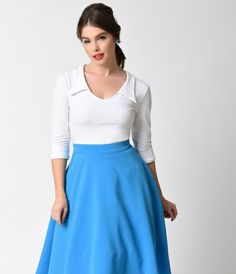 Darlings, it's your retro calling!  A crisp white, retro style blouse, this gorgeous piece is the perfect standard. A sharp winged collar is offset by matching three-quarter sleeves with rolled cuffs and a darted, fitted button up bodice. Made in the USA