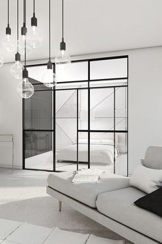 Glass sliding door separates living room from bedroom. Modern style / mostly white interior