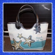 "RARE ~ COACH Starfish Tote #19212 RARE ~ COACH Starfish Tote #19212 RETAIL: $298 + Tax New with Tags Attached! Features: The 3 hangtags give it that special touch! Canvas embroidered and studded Silver Leather / Hardware 9"" Dual Handles Light Blue Interior Dog leash Closure 1 interior zipped & 2 Slip pockets 4 metal feet on Bottom 3 Original Hangtags Dip in center of bag for more arm room Measurements are approximate:  17"" L x  11"" H X  5""W ❌NO TRADE OR PP❌ Coach Bags Totes"
