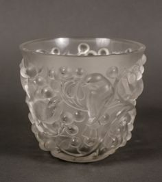 """French, 20th century. Lalique frosted and molded art glass table vase in """"Avalon"""" pattern with birds perched on curving branches surrounded by rounded clustered berries. Stencil signature on base """"LALIQUE FRANCE""""."""