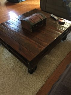 Coffee table made from varnished reclaimed pallet and vintage casters from Caster Connection.